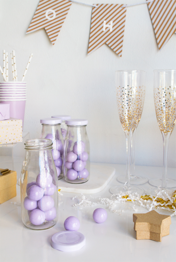 fill milk bottles with lavender colored gumballs or other assorted